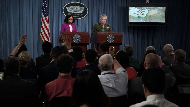 Pentagon Chief Spokesperson Dana W. White, left,  and Marine Lt. Gen. Kenneth F. McKenzie Jr. participate in a news briefing at the Pentagon April 14, 2018 in Arlington, Virginia. The Pentagon held a briefing on the latest development of the strike in Syria.