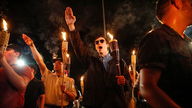 White nationalist groups march through the UVA campus in Charlottesville, Virginia, on Aug. 11, 2017.