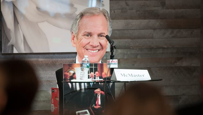 A cutout of Governor Henry McMaster sits in his absence as Republican candidates for governor debate at Zen in Greenville on Monday, May 14, 2018.