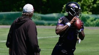 Jul 19, 2018; Owings Mills, MD, USA;  Baltimore Ravens quarterback Lamar Jackson (8) drops back to pass as offensive coordinator Marty Mornhinweg watches during NFL training camp practice at Under Armour Performance Center. Mandatory Credit: Tommy Gilligan-USA TODAY Sports