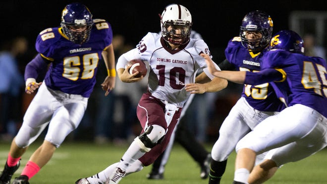 Scott Morgan/For the Register Dowling Catholic quarterback Ryan Boyle, an Iowa recruit, runs the ball against Johnston on Friday night as Clayton Holcomb (45) gets into position to make the tackle. Dowling won 50-13. Dowling High School's Ryan Boyle (10) runs the ball into Johnston's Clayton Holcomb (45) in the first quarter Friday, Oct. 10, 2014, at Johnston High School.