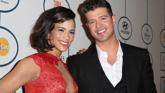 Paula Patton and Robin Thicke in better times, in January 2014 in Beverly Hills.
