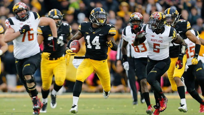 Iowa's Desmond King runs an interception back for a touchdown during a game with Maryland at Kinnick stadium in Iowa City Saturday, Oct. 31, 2015.