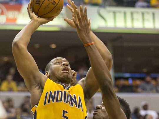 Lavoy Allen of the Pacers, works against Clint Capela of the Houston Rockets at Indiana Pacers, Bankers Life Fieldhouse, Indianapolis, Sunday, March 27, 2016.