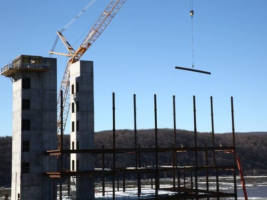 A crane moves a piece of steel at the Vassar Brothers Medical Center construction site in the City of Poughkeepsie on Thursday, January 25, 2018.
