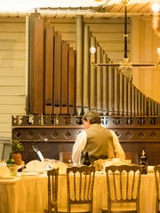 Organist and WRCJ-FM radio host Dave Wagner, playing organ in Thomas Edison's Menlo Park laboratory, located in Greenfield Village, Dearborn. Wagner will be playing the organ on select nights during Holiday Nights in Greenfield Village.