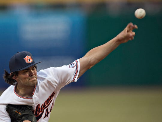 Auburn pitcher Jack Owen throws a pitch during the