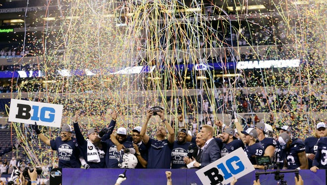 Penn State head coach James Franklin holds the trophy after Penn State defeated Wisconsin 38-31 to win the Big Ten championship NCAA college football game Saturday, Dec. 3, 2016, in Indianapolis.