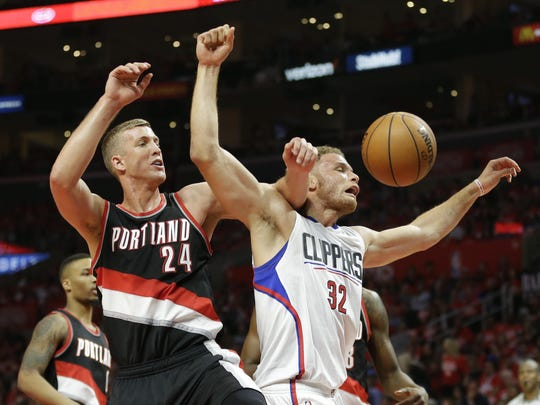 Portland Trail Blazers' Mason Plumlee, left, and Los Angeles Clippers' Blake Griffin fight for a rebound in the first half in Game 1 of a first-round NBA basketball playoff series, on Sunday, April 17, 2016, in Los Angeles. (AP Photo/Jae C. Hong)