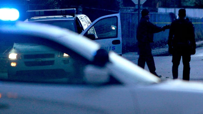 Memphis Police investigate the scene of a shooting