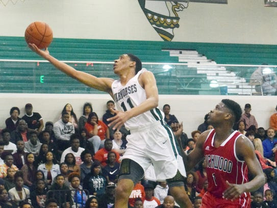 Peabody's Marcus Jones (11) goes for a layup against
