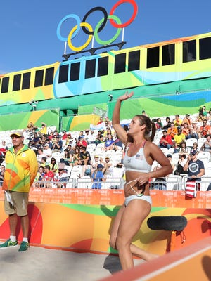 Aug 11, 2016; Rio de Janeiro, Brazil; United States right defender Brooke Sweat (2) enters the arena for a women's preliminary - Pool A match against Russia at the Beach Volleyball Arena during the Rio 2016 Summer Olympic Games. Mandatory Credit: Keven Jairaj-USA TODAY Sports