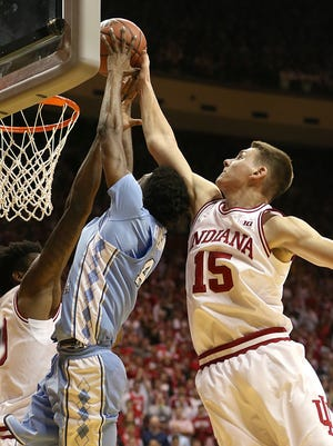 Zach McRoberts took a year off from basketball. IU is glad he reconsidered.  IMcRoberts (15) blocked a shot by North Carolina Tar Heels guard Brandon Robinson during a game Nov. 30 at Assembly Hall.