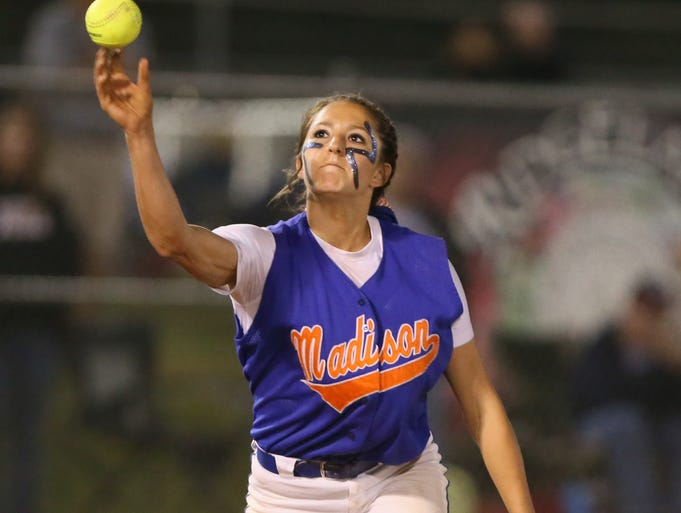 Madison Central's Haylee Morse makes a throw to first base in the Lady Jaguars' game against Harrison Central. Game 1 of the MHSAA Class 6A Fast Pitch Softball Championships between Madison Central and Harrison Central was held Friday, May 16, 2014 at Freedom Ridge Park in Ridgeland. Photo by Keith Warren