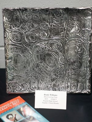 A metal tooling piece made by Puckett High School student Brady Williams is part of the Craftsmen of the Future exhibit at the Chimneyville Craft Festival.
