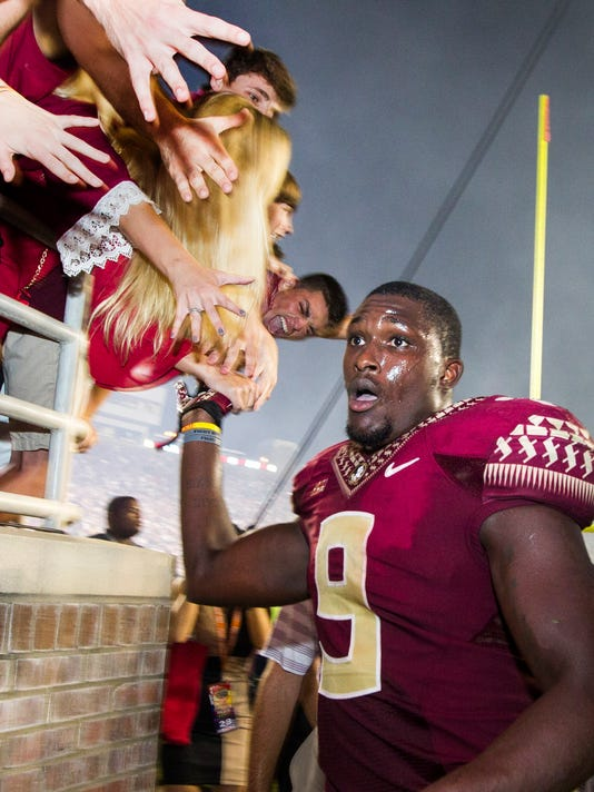 Florida State running back Karlos Williams leaves the field after scorning the game-winning touchdown in overtime of an NCAA college football game against Clemson in Tallahassee, Fla., Saturday, Sept. 20, 2014. Florida State won 23-17.  (AP Photo/Mark Wallheiser)