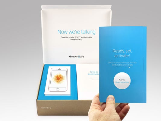 636270649649644808-iPhone-Xfinity-Mobile-Unboxing.jpg