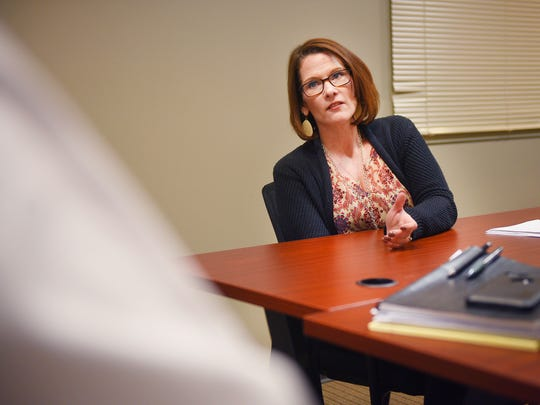 Traci Smith, Minnehaha County Public Defender talks to Mike Miller, Chief Deputy Public Defender, about increasingly high caseloads Monday, Feb. 26, at the Minnehaha County Public Defender's Office.