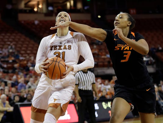 Texas forward Audrey-Ann Caron-Goudreau (31) drives to the basket past Oklahoma State forward Mandy Coleman (3) during the first half of an NCAA college basketball game, Wednesday, Jan. 3, 2018, in Austin, Texas. (AP Photo/Eric Gay)