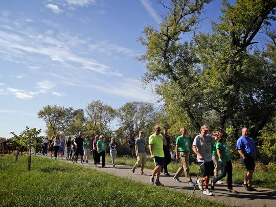 Walkers take to the Clive Greenbelt trail for a 1K