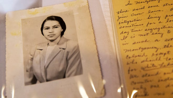 FILE - In this Jan. 29, 2015 shows a photograph of Rosa Parks circa the 1950's and a paper written by Parks about segregation are some of the items in the Rosa Parks archive, seen during a media preview at the Library of Congress, Madison Building in Washington. The family of civil rights activist Rosa Parks is thankful her memorabilia and personal items finally have a safe home. The items are on loan to the Library of Congress. They were purchased last year by a charitable foundation run by Howard Buffett, son of billionaire investor Warren Buffett.  (AP Photo/Jacquelyn Martin, File)