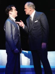 Brian d'Arcy James, left, as Sidney Falco, and John
