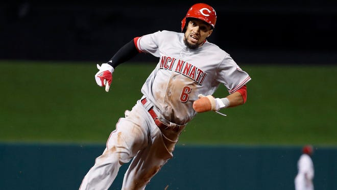 Cincinnati Reds' Billy Hamilton rounds third and heads home to score on a double by Joey Votto during the sixth inning of a baseball game against the St. Louis Cardinals on Friday, April 7, 2017, in St. Louis. (AP Photo/Jeff Roberson)