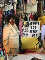 Elizabeth McMurray, owner of Liz's Alterations, poses