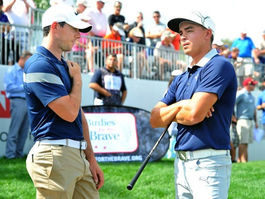 Golfers Rory McIlroy (left) and Rickie Fowler met between holes on Wednesday during the 2016 Honda Classic Cares Pro-Am golf tournament at PGA National Resort & Spa in Palm Beach Gardens.