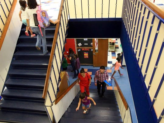 GABE HERNANDEZ/CALLER-TIMES Families walk up the stairs as they take a tour of Sanders Elementary School during the Meet and Greet event on Thursday.