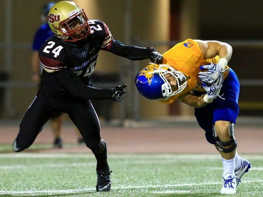 GABE HERNANDEZ/CALLER-TIMES Midwestern State's Robert Grays makes a sack on Sept. 17 against Texas A&M-Kingsville. The Mustangs rallied to win that game, 32-30.