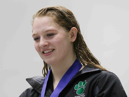 Yorktown's Emily Weiss is awarded first place in the girls 100 yard breaststroke, during the IHSAA girls swimming state finals, held at IUPUI Natatorium, Feb. 11, 2017.