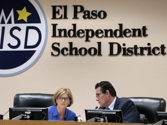 EPISD Board President Dori Fenenbock talks with Trustee Al Velarde after leaving executive session Tuesday morning.