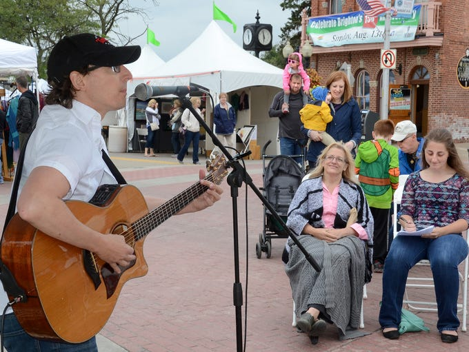 Mike Vial entertains at the West Street stage Friday,