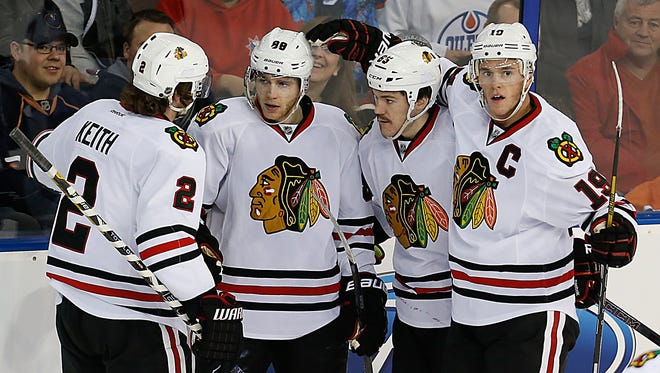 Patrick Kane, second from left, celebrates his first-period goal for Chicago.