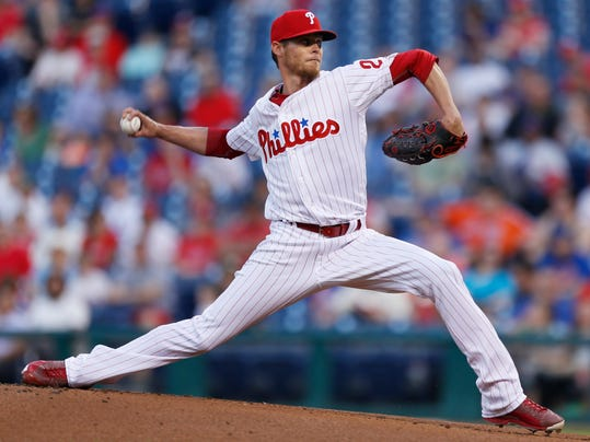 FILE - In this April 11, 2017, file photo, Philadelphia Phillies starting pitcher Clay Buchholz throws during the first inning of the team's baseball game against the New York Mets in Philadelphia.Buchholz is the latest Kansas City Royals reclamation pitching project. Buchholz and the Royals have finalized a minor league contract. (AP Photo/Laurence Kesterson, File)