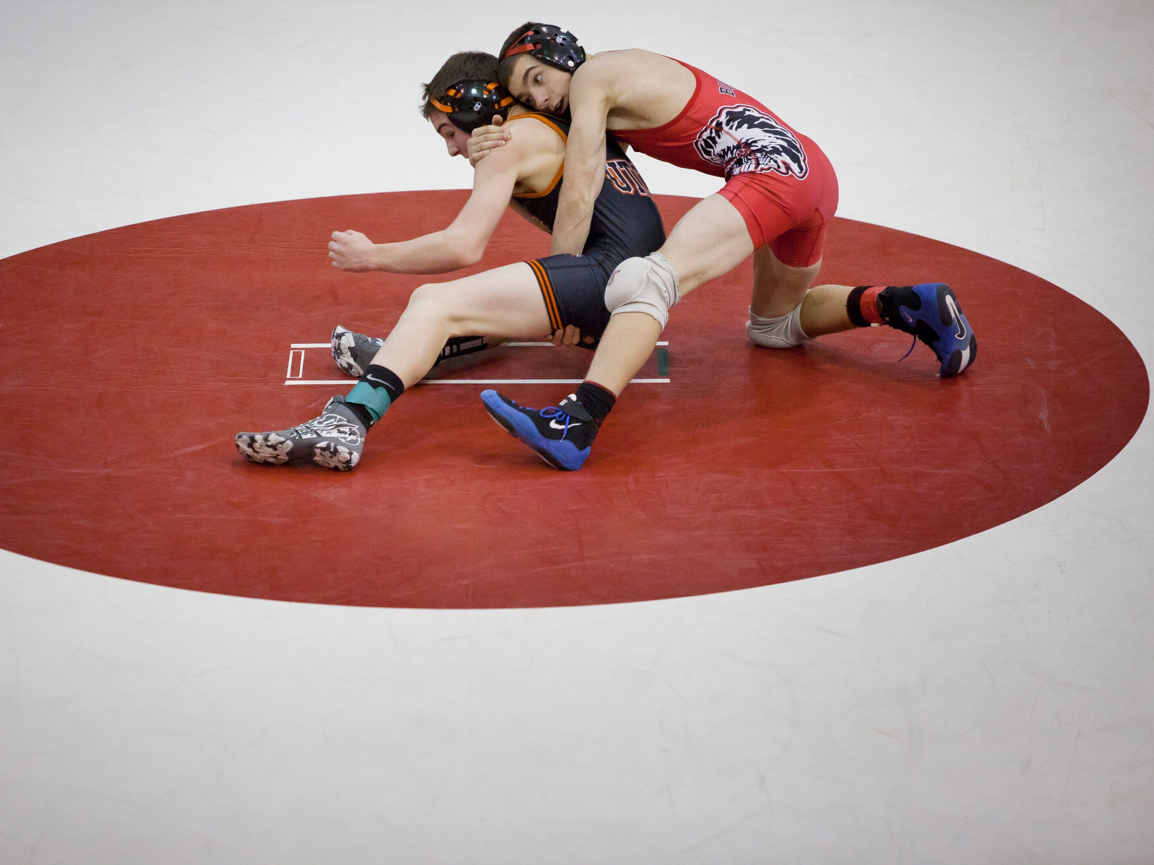 Port Huron's Doug Ferrier wrestles Utica's David Stemple Wednesday, Jan. 14, 2015 at Port Huron High School.