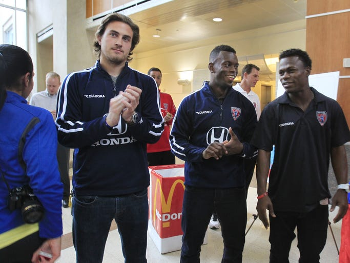 Players for Indianapolis' new professional soccer team, the Indy Eleven, from left, Jon Dawson, Erick Norales and Walter Ramirez were on hand at the team's kickoff party on Tuesday, March 11, 2014 at the Emmis Communications Building on Monument Circle to publicize their inaugural season that begins in just one month, a home game against the Carolina RailHawks on Saturday, April 12.