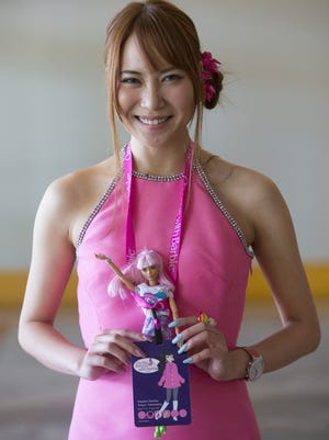 Kanako Namba, from Japan, poses with her Barbie during the Barbie Collectors National Convention at JW Marriott Desert Ridge Resort & Spa in Phoenix on July 12, 2018.