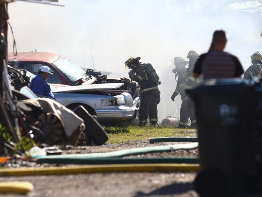 Seven vehicles caught fire inside a junkyard at the corner of Holly Road and Ayers Street about 10 a.m. Thursday.