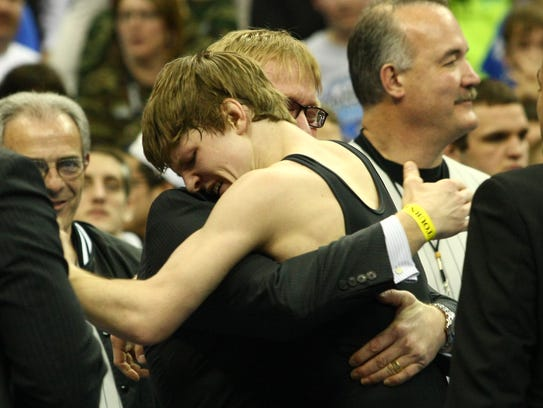 2012: Four-time state champion Cory Clark embraces