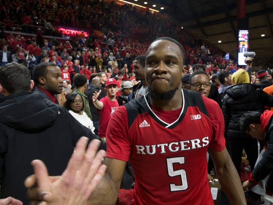 Rutger's Mike Williams celebrates with fans after game.Rutgers