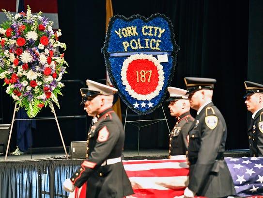 Members of the U.S. Marine Corps and York City Police