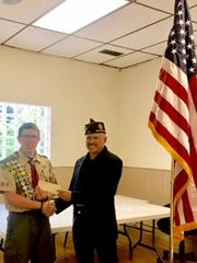 Dawson Innes (left) was honored for his Eagle Scout flag project at Highland Veteran Memorial.