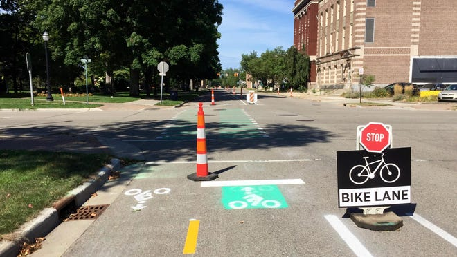 """In mid-August, the city of Holland tested out a two-way """"cycle track"""" model for bike infrastructure on 10th Street. Residents can give their input on the trial and the 10th Street reconstruction project which could include the cycle track at a public meeting on Sept. 10."""