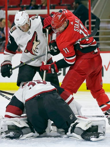 Arizona Coyotes' Kevin Connauton (44) and goalie Darcy