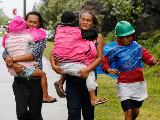 Filipino residents evacuate to safer ground in Pinalangga,