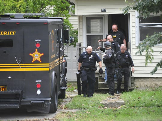 Members of the Crawford County Special Response Team practice swarming a Bucyrus house in October of 2017.