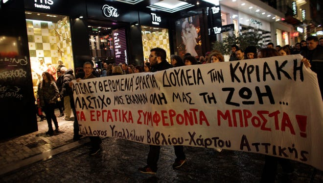Protesters march through Athens' Ermou shopping street in December during a protest against the opening of shops on Sundays.