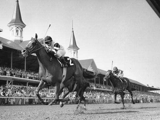 Affirmed crosses the finish line in the 1978 Kentucky Derby.